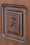Fragment beautiful carved brown wooden door Royalty Free Stock Images