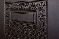 Fragment beautiful carved brown wooden door Royalty Free Stock Photography