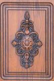 Fragment beautiful carved brown wooden door Stock Photo