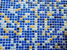 Fragment of beautiful mosaic on the facade of the building. Abstract colored ceramic puzzles as decorative background royalty free stock image