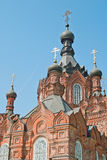 Fragment of a beautiful old church. On blue sky background Stock Photography