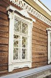 Fragment of a beautiful old wooden house. Rustic retro house stock photography