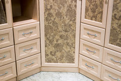 Fragment of beige cupboard with drawers Stock Photography