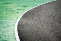Green, white and gray texture of race track stock image