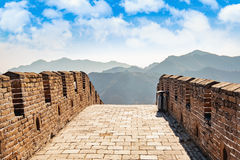 Fragment of Big China Wall. With cloudy sky royalty free stock image