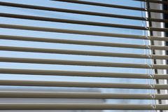 Fragment of blinds on the window. You can see the sky through the blinds stock images