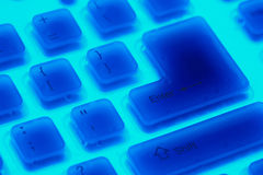 Fragment of blue backlit flexible keyboard Stock Images