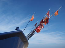 Fragment blue  fishing boat with flag Royalty Free Stock Photos