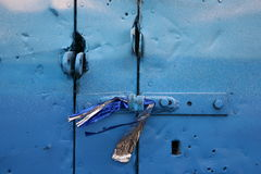 A fragment of a blue-iron gate in the old garage Stock Photography