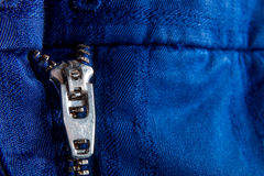 Fragment of blue jacket with metal zipper. ziplock background. Close up. Royalty Free Stock Photos