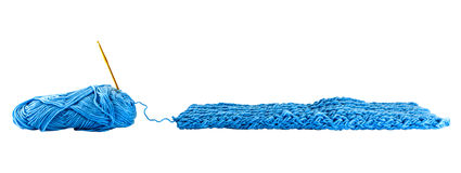 Fragment blue knitting cloth with neddle Stock Image