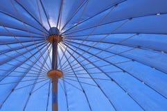 Fragment blue stripe umbrela viewed from the bottom Stock Photos