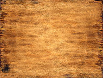 Fragment of a board. Fragment of the old wooden board which have darkened from time. It can be used as a background Stock Photo
