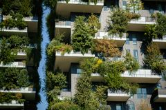 Fragment of Bosco Verticale, vertical forest apartment buildings in the business district of Porta Garibaldi, warm toned. Milan, Italy, October 9, 2017 royalty free stock image