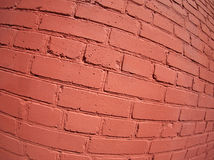 A fragment of a brick wall painted Stock Photos