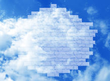A fragment of a brick wall transparent against the blue sky Royalty Free Stock Images
