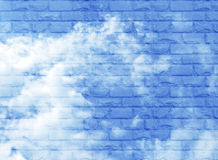 A fragment of a brick wall transparent against the blue sky Royalty Free Stock Photo