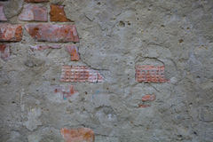 Fragment of a building with a collapsed brick wall. Stock Photography