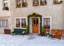 Fragment of the building in Gruyere with Christmas decoration Royalty Free Stock Photos