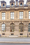 Fragment of the building of Louvre Museum. Paris, France Stock Photo