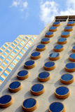 The fragment of a building with round windows. Royalty Free Stock Photos