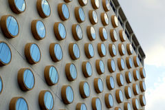 The fragment of a building with round windows. Stock Photos