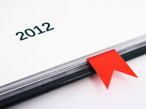 Fragment of business diary on 2012 year. With red bookmark in it Royalty Free Stock Photography