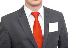 Fragment of businessman black suit and blank card. Royalty Free Stock Photography
