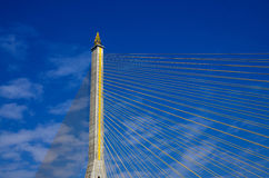 Fragment of a cable stayed bridge on blue the sky background. Royalty Free Stock Photos