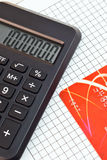 A fragment of a calculator and a credit card Stock Photos
