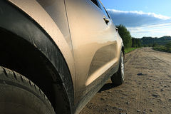 Fragment of the car on the road Stock Photos