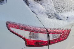 Fragment of car with tail lamps, covered with fluffy snow Stock Images