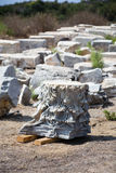 Fragment of carved marble column. With pieces of other columns as blurred background in Antiochia ad Cragum Gazipasha and Alanya Turkey Royalty Free Stock Photography