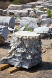 Fragment of carved marble column. With pieces of other columns as blurred background in Antiochia ad Cragum Gazipasha and Alanya Turkey Stock Image