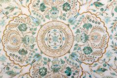 Fragment carved marble panels with floral patterns. Of enamel, gold and nacre Stock Images