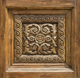 Fragment of a carved wooden door Royalty Free Stock Photography