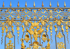 Fragment of Catherine palace fence in Tsarskoye Selo. Fragment of Catherine palace fence in Tsarskoye Selo with golden double-headed eagle, suburb of St stock image