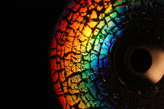 Fragment of CD disk covered by cracks Stock Photo
