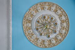 Fragment of the ceiling and chandelier of the interior of the Ma stock photography