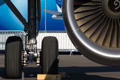A fragment of the chassis and engine. Landing gear, and a fragment of a jet engine Royalty Free Stock Photography