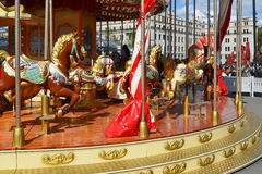Fragment of children`s merry-go-round with horses in Moscow, Russia Royalty Free Stock Image