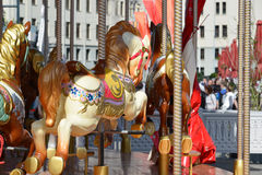 Fragment of children's merry-go-round with horses in Moscow, Russia Royalty Free Stock Photos