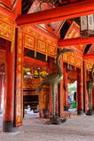 Fragment of Chinese temple. Chinese temple in Hanoi, Vietnam. Red wooden interior stock photo