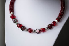 Fragment of choker necklace made from beads and beaded rope Royalty Free Stock Image