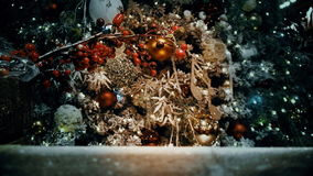 A Fragment of a Christmas tree decorated with toys and garlands stock video