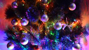 Fragment of a Christmas tree with toys and lighting stock footage