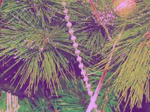 Fragment of Christmas tree with toys. Tinted picture Royalty Free Stock Photography