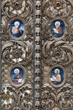 Fragment of the church door Stock Photos