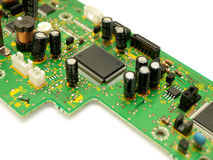 Fragment of a circuit board. Focus on microchip Royalty Free Stock Photography
