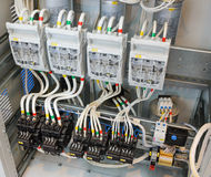 Fragment of circuit in the power control cabinet. Royalty Free Stock Photo
